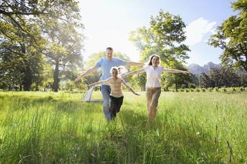 Family running in field