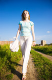 Young independent woman walking. Wide angle view. poster