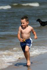 Child running and splashing the water