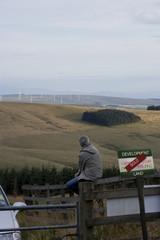 Man overlooking property