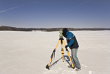 Winter land surveying - measurements with total station. poster