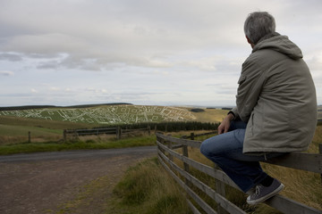 Man overlooking housing development layout