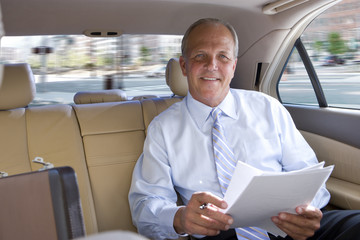 Businessman riding in town car