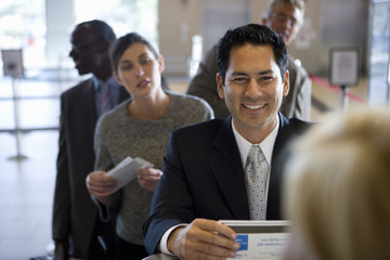 Businesspeople waiting in line in airport