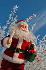 Toy Santa Claus on a background of a winter garden