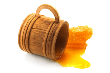 honey on wood cup isolated