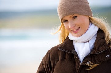 A young attractive woman outside in winter wear