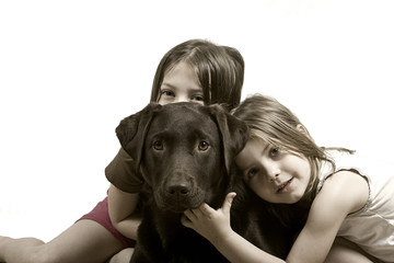 Two Sisters with Labrador Puppy