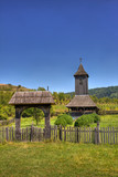 Wooden church and gate in Nadasa, Romania. poster