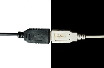 The connected black and white USB cables