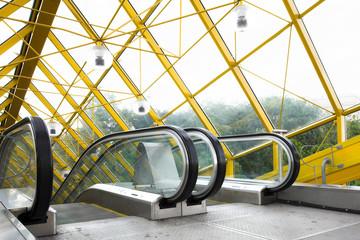 Mooving escalators and stairs, bridge with spheres