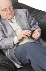 Close-up image of a senior man taking his medication.
