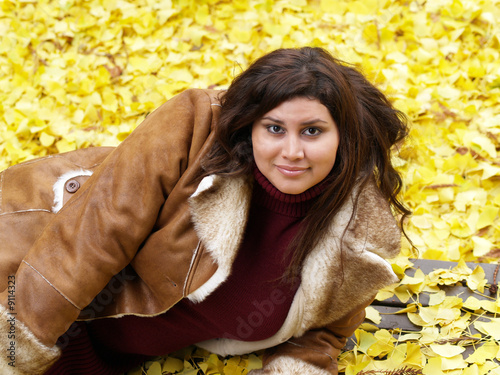 young plump woman wearing jacket fall leaves