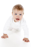 A cute baby boy crawling across the floor poster