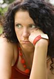 outdoor portrait of unhappy attractive brunet woman poster