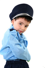 Adorable five year old boy in cop costume.