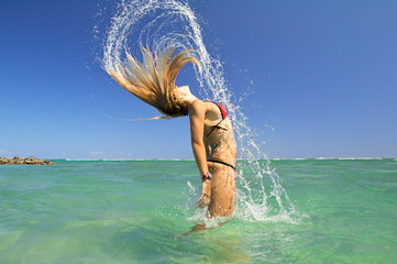 Bikini model tossing hair creating interesting water effect