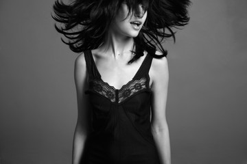 Fashion portrait of young attractive lady. Black and white photo