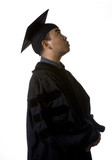 Model in graduation robes and regalia looking up hopefully poster