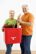 Couple with recycling bin.