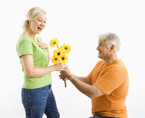 Man giving woman bouquet.