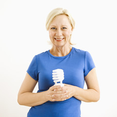 Woman holding lightbulb.