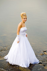 closeup portrait of bride dressed in wedding gown in water