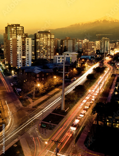 canvas print picture A busy road in Santiago with the Andes in the background