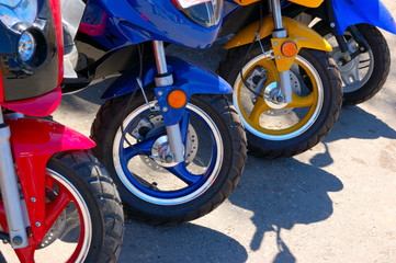closeup of row of scooter wheels