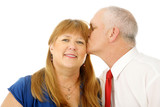 Beautiful woman receiving a kiss on the cheek from husband poster