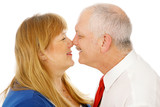 Adorable mature couple in love rubbing noses. Isolated poster