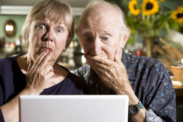 Perplexed Senior Couple with a Laptop Computer