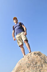 Middle aged hiker standing on top of a mountain