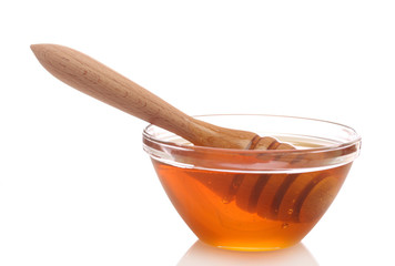 Honey in bowl with wood stick