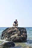 Man stranded on a rock in ocean waiting for rescue poster