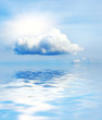 Small cloud and sun reflected in water
