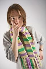 thoughtful young woman in long t-shirt and striped muffler