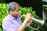 Jazz musician playing his horn. poster