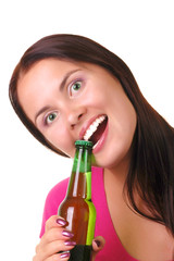 Smiling young woman with bottel of beer
