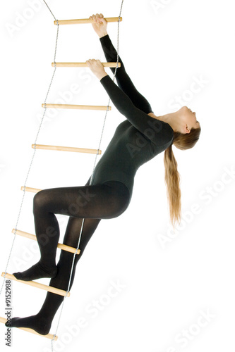 Isolated photo of a woman on a rope ladder