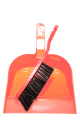 Brush and dustpan on white background