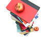 Large piles of books with apples on white background