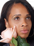 Portrait of young black woman with pink rose to cheek poster