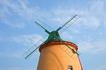 New windmill with four limbs on sky.