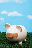 Piggy bank with adhesive bandage on mouth, investment trouble poster