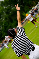 American football referee with hands up - Judge concept