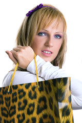 Young blond girl with shopping bag, isolated on white background