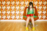 Girl with heart shaped box on knees poster