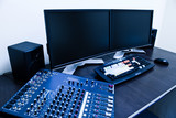 editing station with audio mixer and dual monitor poster
