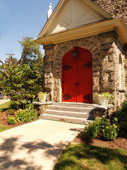 two red church doors for a country church